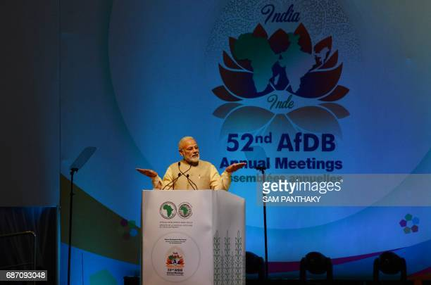Indian Prime Minister Narendra Modi speaks at the start of the African Development Bank annual general meeting in Gandhinagar some 30 kms from...