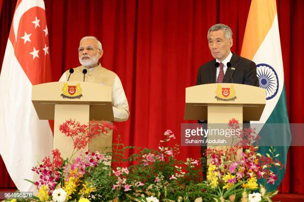 Indian Prime Minister Narendra Modi speaks during a joint press conference as Singapore Prime Minister Lee Hsien Loong looks on at the Istana on June...