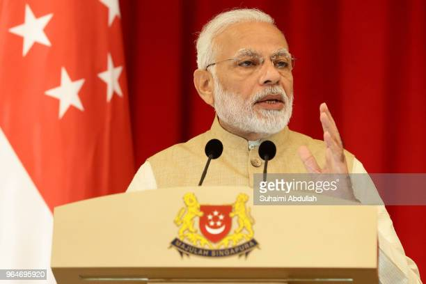 Indian Prime Minister Narendra Modi speaks during a joint press conference at the Istana on June 1 2018 in Singapore Narendra Modi is on a three day...