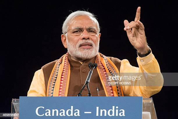 Indian Prime Minister Narendra Modi speaks to a crowd during a rally on Prime Minister Modi's first official visit to Canada April 15 2015 in Toronto...