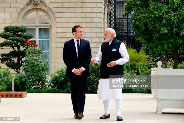 Indian Prime Minister Narendra Modi speaks with French President Emmanuel Macron at the Elysee Palace following their meeting on June 3 2017 in Paris...