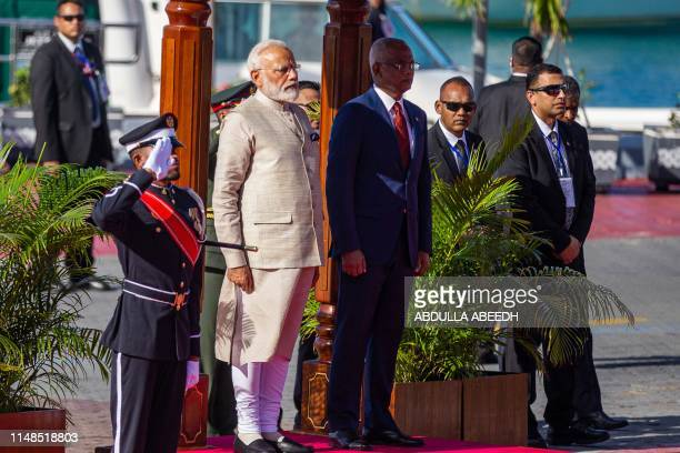 Indian Prime Minister Narendra Modi stands next to Maldives' President Ibrahim Mohamed Solih during a welcome ceremony at Republic square in...
