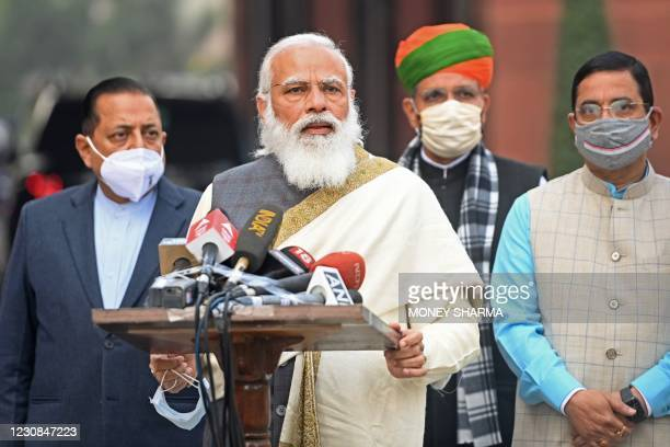 Indian Prime Minister Narendra Modi stands with Bharatiya Janata Party leaders as he addresses the media representatives upon his arrival for the...