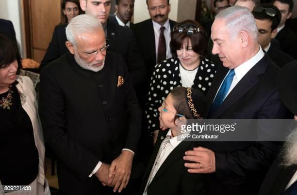 Indian Prime Minister Narendra Modi talks with Moshe Holtzberg son of slain US Rabbi Gavriel Holtzberg who was killed with his wife in the November...