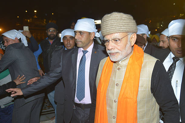 Indian Prime Minister Narendra Modi visits the Golden temple in Amritsar on December 3 2016 Modi visited the city on the sideline of the 6th Heart of.