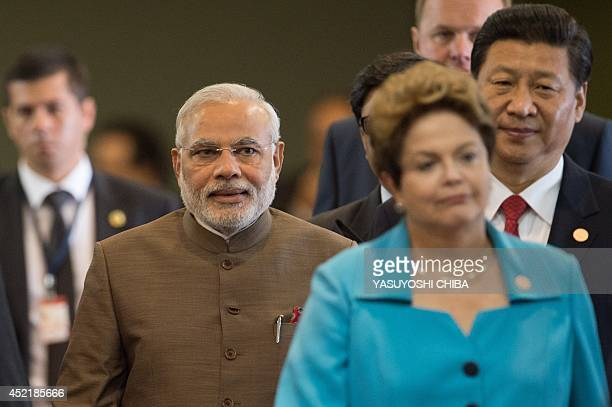 Indian Prime Minister Narendra Modi walks next to Brazilian President Dilma Rousseff and Chinese President Xi Jinping during the 6th BRICS Summit in...
