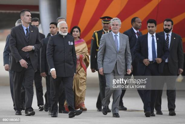 Indian Prime Minister Narendra Modi walks with Spanish Foreign Affairs Minister Alfonso Dastis after his arrival at Torrejon military air base in...