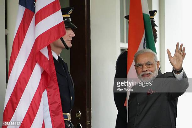 Indian Prime Minister Narendra Modi waves as he arrives outside the West Wing of the White House for an Oval Office meeting with US President Barack...