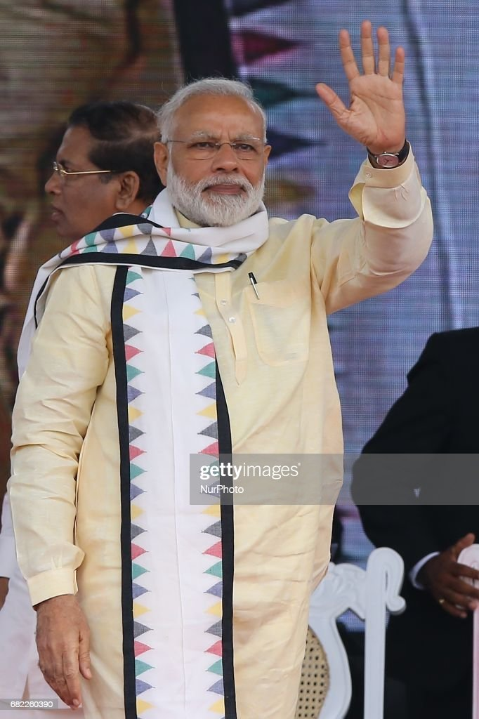 Indian Prime Minister Narendra Modi waves to supporters after addressing a public rally in the tea-growing town of Norwood, some 80kms east of Colombo on May 12, 2017.