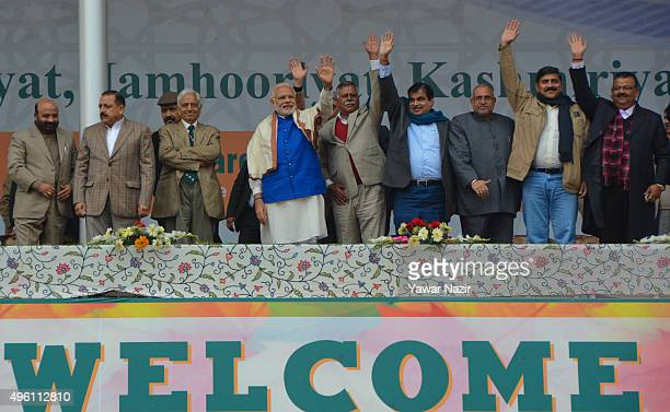 Indian Prime Minister Narendra Modi waves to supporters during a public rally at Sheri Kashmir cricket stadium on November 07 2015 in Srinagar the...