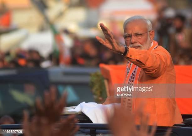Indian Prime Minister Narendra Modi waves towards supporters during his road show in Varanasi on April 25 2019 PM Modi is visiting his parliamentary...