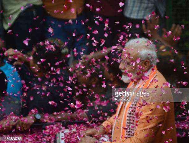 Indian Prime Minister Narendra Modi waves towards supporters during his road show in Varanasi on April 25, 2019 . PM Modi is visiting his...