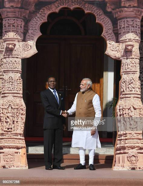 Indian Prime Minister Narendra Modi welcomes Equatorial Guinea President Teodoro Obiang Nguema Mbasogo to the founding conference of the...