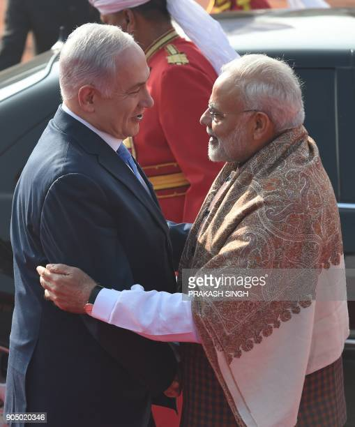 Indian Prime Minister Narendra Modi welcomes Israeli Prime Minister Benjamin Netanyahu at the start of a ceremonial reception at the Predential...