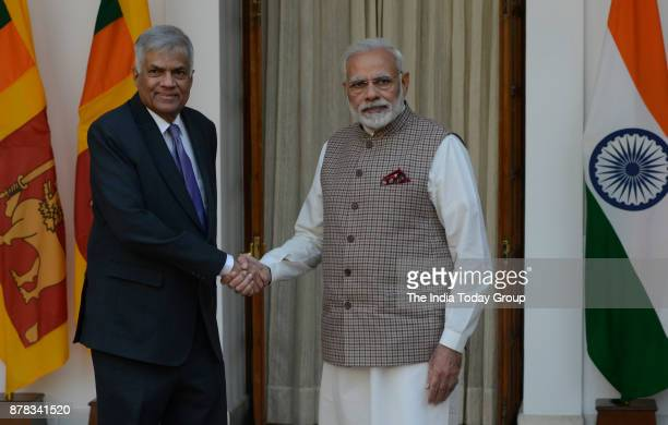 Indian Prime Minister Narendra Modi with Sri Lankan Prime Minister Ranil Wickremesinghe before a meeting at Hyderabad House in New Delhi