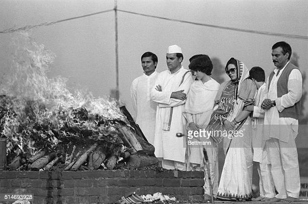 Indian Prime Minister Rajiv Gandhi, accompanied by his wife Sonia and his daughter Priyanka, attends the cremation of his mother, former Prime...