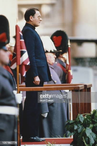 Indian Prime Minister Rajiv Gandhi watches a guard of honour at the British Foreign Office ahead of his meeting with British Prime Minister Margaret...