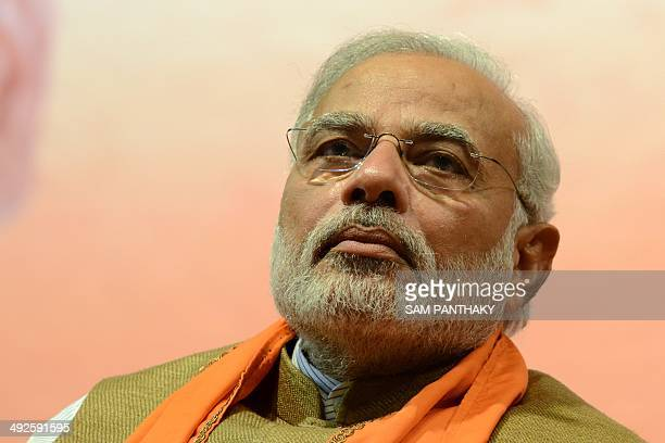Indian Prime MinisterElect Narendra Modi gestures during the announcement of Gujarat's first woman chief minister Anandiben Patel during a meeting at...
