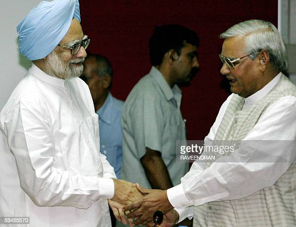 Indian Prime Ministrer Manmohan Singh shakes hands with former Prime Minister Atal Behari Vajpayee during an allparty meeting in New Delhi 24 August...