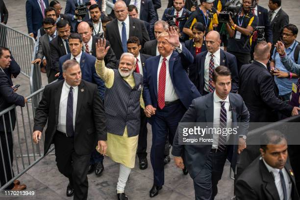Indian Prime Minster Narendra Modi and US President Donald Trump leave the stage at NRG Stadium after a rally on September 22 2019 in Houston Texas...