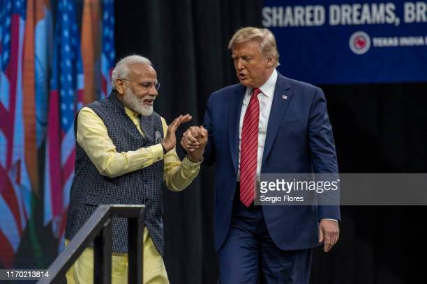 Indian Prime Minster Narendra Modi welcomes US President Donald Trump to the stage at NRG Stadium during a rally on September 22 2019 in Houston...