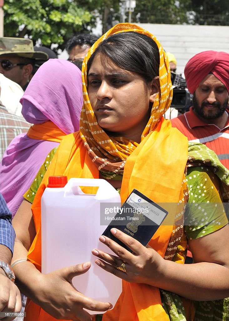 Indian prisoner in Pakistan Sarabjit Singh's elder daughter Swapandeep Kaur carries the container of holy water of Sarover of Harmandar Sahib (Golden Temple) for Sarabjit as crossing over to Pakistan at India-Pakistan Attari border on April 28, 2013 near Amritsar, India. Pakistani doctors treating a comatose Sarabjit Singh today said there has been no improvement in his condition and chances of survival are slim even as his distraught family visited him and demanded that he be sent to India for better treatment. Sarabjit was admitted to the state-run Jinnah Hospital with a severe head injury after being attacked by prisoners. Sarabjit was convicted for alleged involvement in a string of bomb attacks in Punjab province that killed 14 people in 1990.