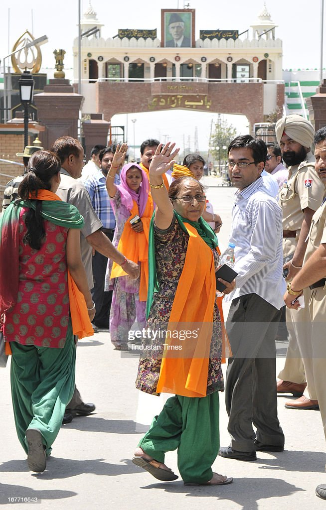 Indian prisoner in Pakistan Sarabjit Singh's sister Dalbir Kaur waves before crossing over to Pakistan at India-Pakistan Attari border on April 28, 2013 near Amritsar, India. Pakistani doctors treating a comatose Sarabjit Singh here today said there has been no improvement in his condition and chances of survival are slim even as his distraught family visited him and demanded that he be sent to India for better treatment. Sarabjit was admitted to the state-run Jinnah Hospital with a severe head injury after being attacked by prisoners. Sarabjit was convicted for alleged involvement in a string of bomb attacks in Punjab province that killed 14 people in 1990.