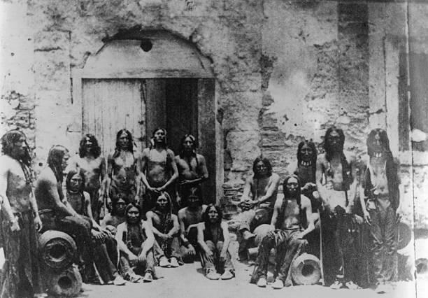 Indian prisoners at Fort Marion. Wohaw sits in the...