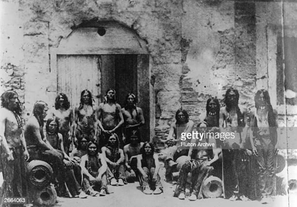 Indian prisoners at Fort Marion Wohaw sits in the centre with his hands clasped over his knees
