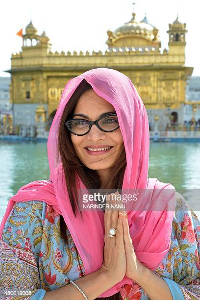 Indian producer Alvira Khan poses for a photograph at the Golden Temple in Amritsar on March 22 2014 AFP PHOTO/NARINDER NANU