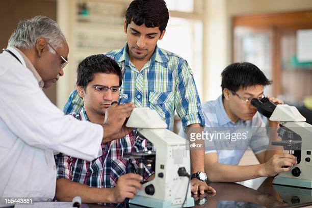 Indian Professor Teaching Students Microscopy