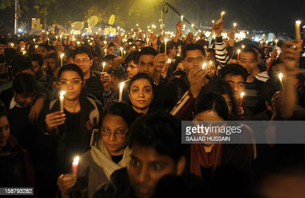 Indian protesters hold candles during a rally in New Delhi late December 29 after the death of a gang rape victim from the Indian capital Indian...