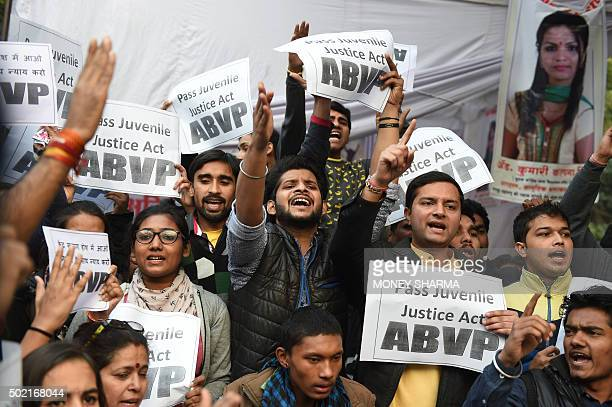Indian protesters hold placards and shout slogans during a demonstration against the release of a juvenile rapist in New Delhi on December 21 2015...