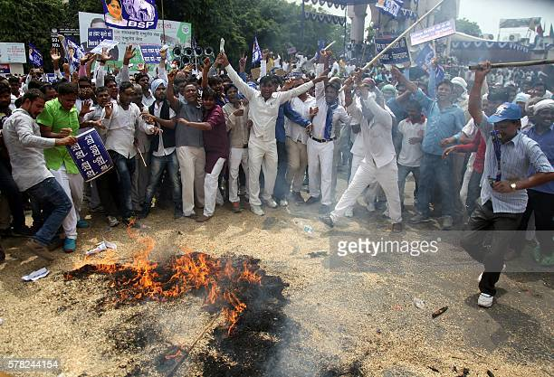 Indian protesters rally against Bharatiya Janata Party official Dayashankar Singh who was expelled from his party for comparing politician and Dalit...