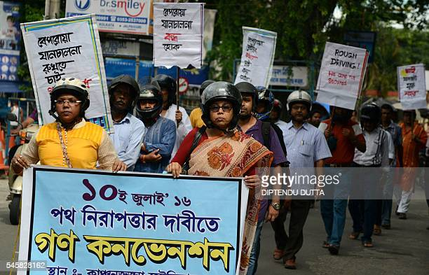 Indian protesters wearing helmets take part in a rally to raise awareness of road safety in Siliguri on July 10 2016 West Bengal police ruled that...
