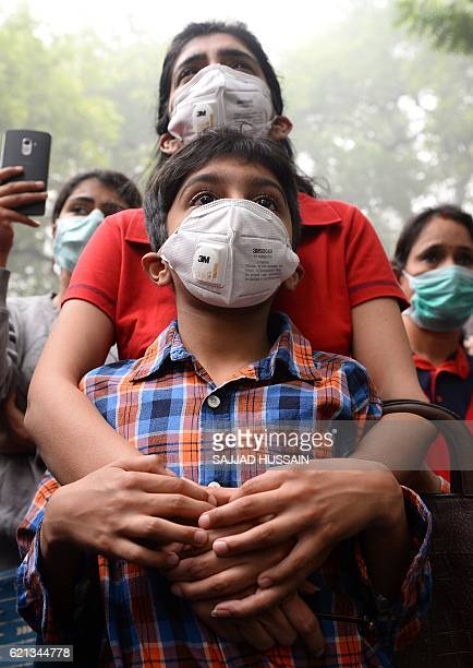 Indian protesters wearing protective masks take part in a rally urging immediate action to curb air pollution in New Delhi on November 6 2016 Schools...