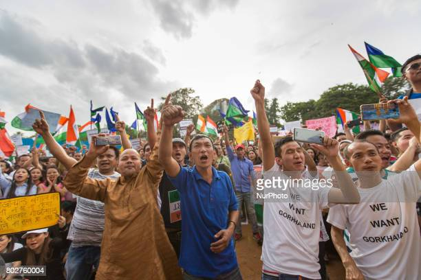 Indian protestors gather during a protest to show their support for the formation of a separate Gorkhaland State in Bangalore India on June 29 2017
