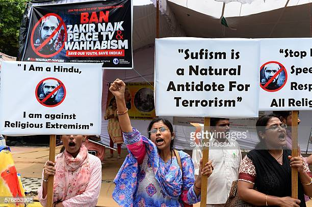 Indian protestors hold placards as they shout slogans during a protest denouncing Islamic scholar Zakir Naik in New Delhi on July 18 2016 Indian...