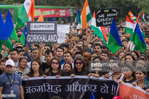Indian protestors hold play cards during a protest to show their support for the formation of a separate Gorkhaland State in Bangalore India on June...