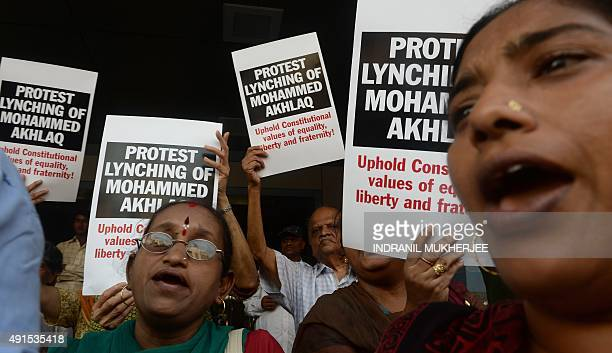 Indian protestors shout slogans during a demonstration to condemn the lynching and murder of an Indian Muslim in Mumbai on October 6 2015 50yearold...
