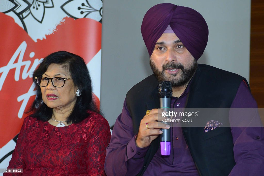 Indian Punjab Cabinet Minister Navjot Singh Sidhu and Air Asia x Malaysia Chairman Tan Sri Rafidah Aziz speak to the media during the launch of new...
