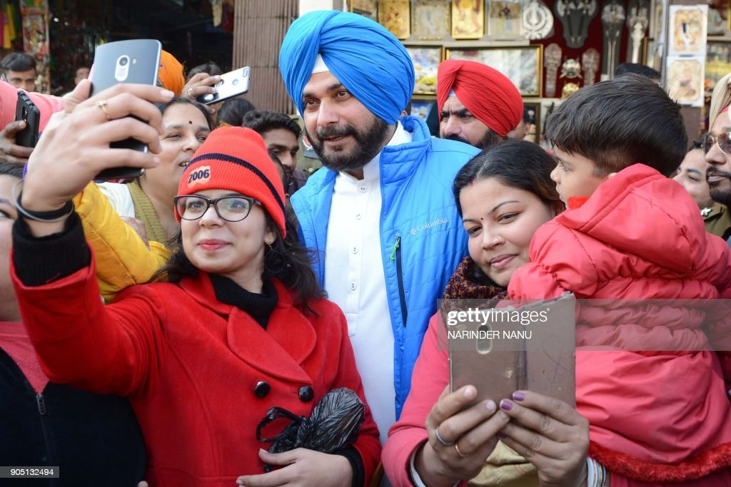 Indian Punjab Minister of Local Government Navjot Singh Sidhu along with his fans poses for selfie pictures after his visit at Jallianwala Bagh in...