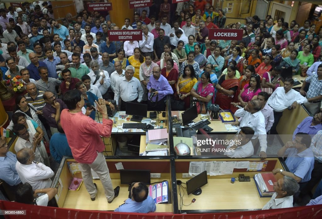 Indian Punjab National Bank workers stage a protest inside a branch in Mumbai on May 30 2018 Nearly one million Indian public sector and regional...