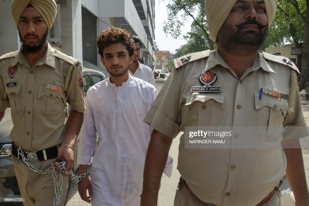 Indian Punjab police escort Pakistani national identified as 21yearold Abdul to court in Amritsar on May 27 2017 The Pakistani man is accused of...