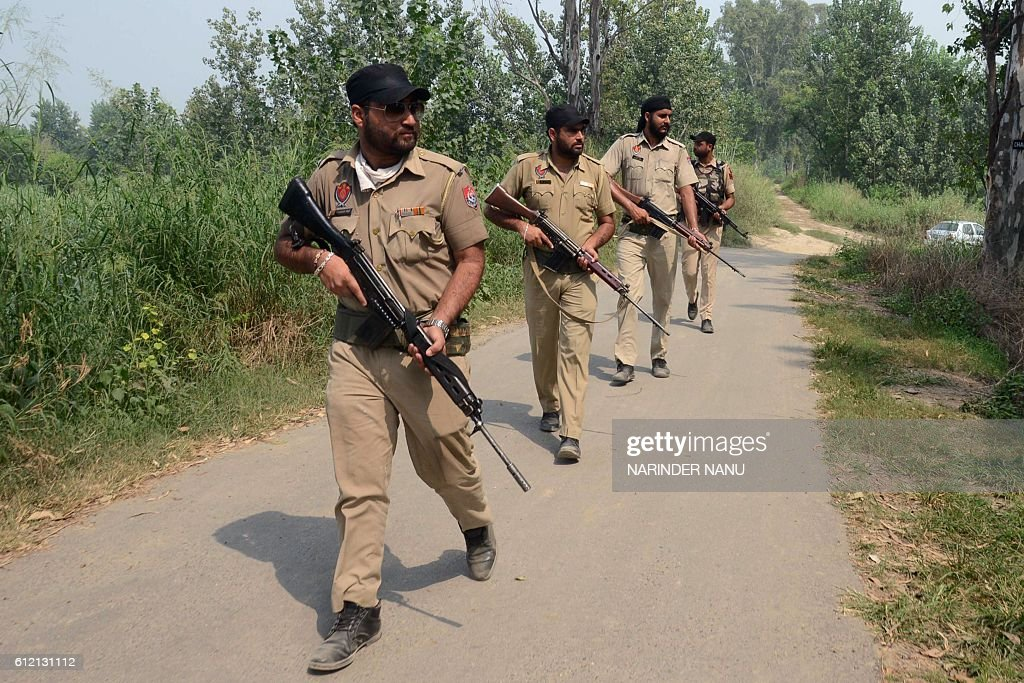 Indian Punjab police patrol near the IndianPakistan border Chakri post about 20km from Gurdaspur on October 3 2016 Pakistani and Indian troops on...