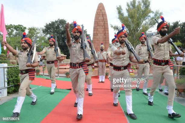 Indian Punjab police pay tribute during the 99th anniversary of the Jallianwala Bagh massacre at the memorial in Amritsar on April 13 2018 The...