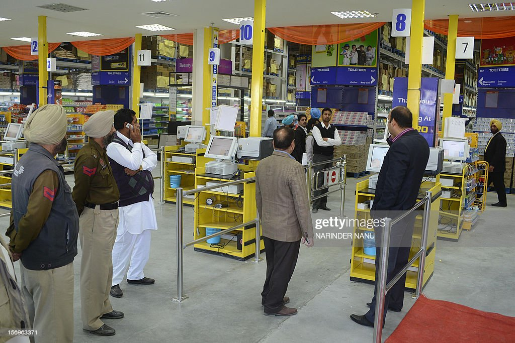 Indian Punjab police personnel guard the opening of the 14th Metro Cash and Carry wholesale store on the outskirts of Amritsar on November 26 2012...