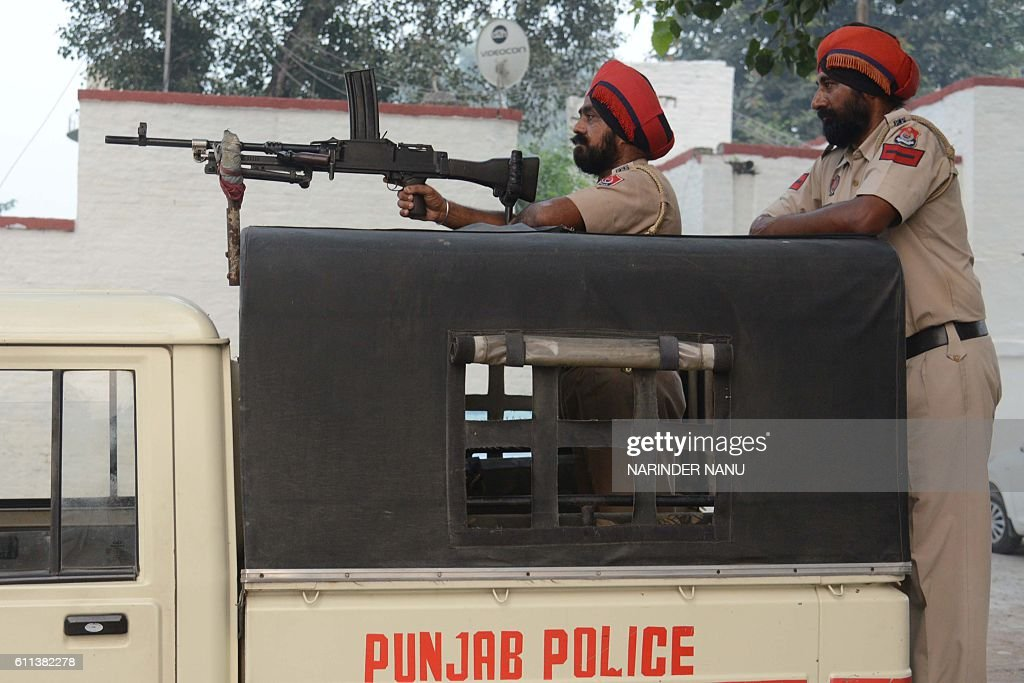 Indian Punjab police personnel stand guard at Attari Railway Station about 35 kms from Amritsar on September 29 2016 Indian commandos carried out a...