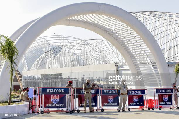 Indian Punjab Police personnel stand guard at the Passenger Terminal Building during the inauguration ceremony of the Shrine of Baba Guru Nanak Dev...