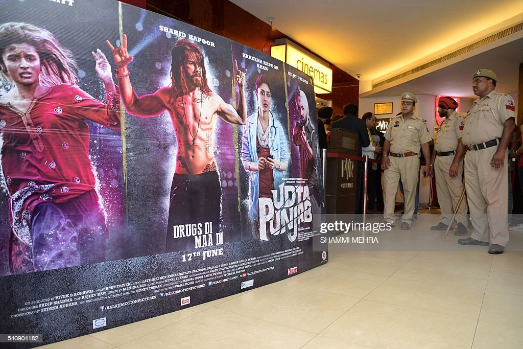 Indian Punjab Police stand in the lobby of a cinema hall as the controversial Bollywood movie `Udta Punjab` is released countrywide following heavy...